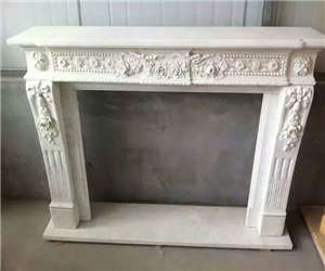 white fireplace carving